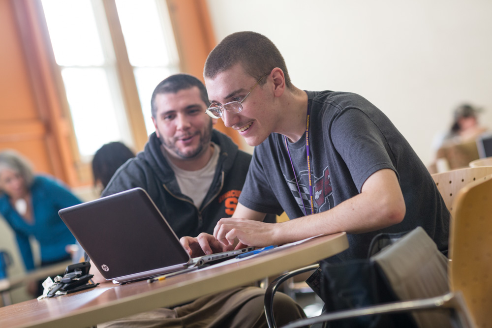 two men studying in class at Nazareth College